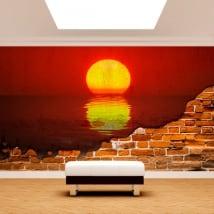 Murales en vinilo sol atardecer mar pared rota