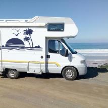Vinilos decorativos autocaravanas atardecer en la playa